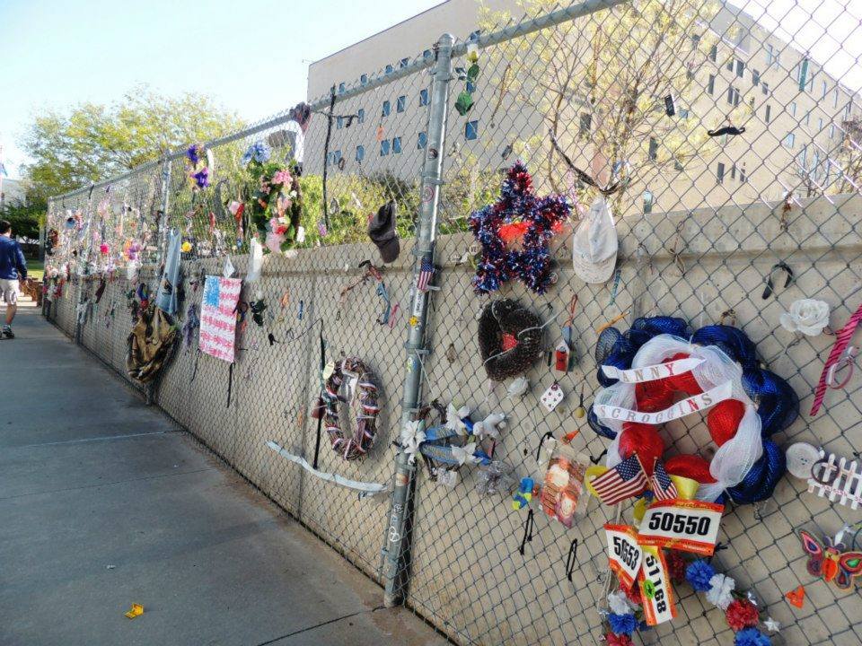 This is one of the fences surrounding the bombing memorial. On race weekend, runners add their bibs to the letters, stuffed animals, flags, and flowers.