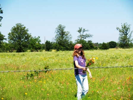 My beautiful firstborn picking me some wildflowers, Mother's Day 2007