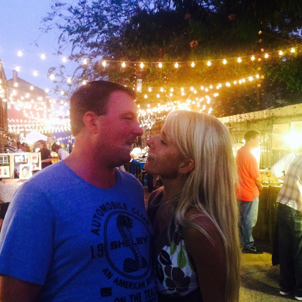 This snapshot was taken in the French Quarter at a very cool little artists' walk we both love. He was refusing to let me smooch him like I wanted to. Then he grabbed me and held me up in the air. xoxo