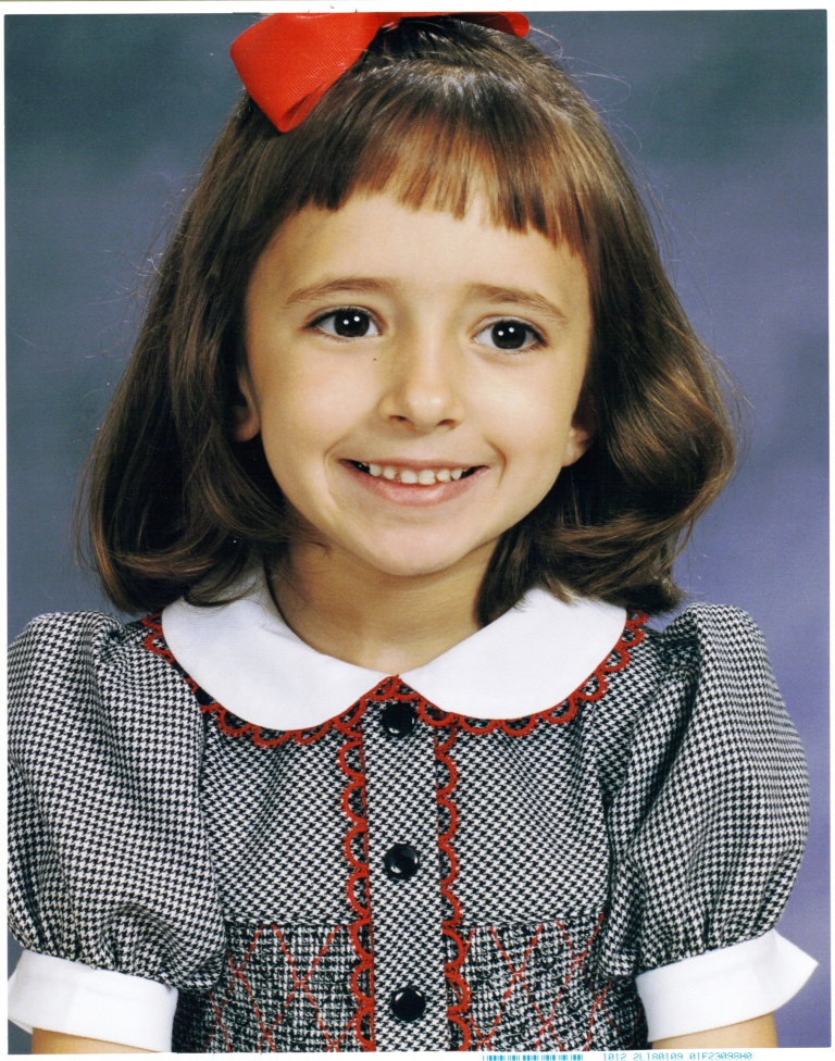 My baby in kindergarten. I remember thinking then how grown up she was.