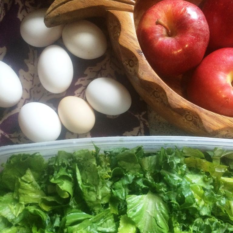 hard boiled eggs, fresh fruit, and a crisp green salad