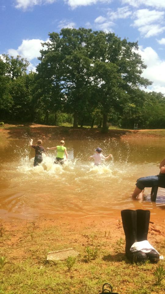Two nieces and a nephew making the most of our red dirt pond, just like our girls once did...xoxo